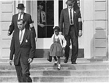 """November 14, 1960 - Ruby Bridges escorted by U.S. Marshalls to and from the first day of integrated school in New Orleans.  Most teachers refused to teach while a black child was enrolled at William Frantz Elementary. Teacher Barbara Henry, from Boston,  taught  Ruby  alone, """"as if she were teaching a whole class."""""""