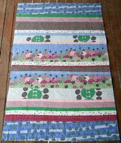 A Magical Lands Strip Quilt- This quilt is really quite different from others I have pinned on the internet... with the right colors this would just pop! would be pretty even as a wall hanging!