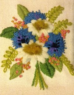 1970s crewel work- stem, split and satin stitch, lazy daisy, French knot and a fun tufty stitching I don't know the name of!