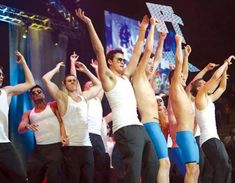 """PENN STATE – STUDENT LIFE – The men's swimming team throws their hands in the air and makes the letters """"FTK"""" at the end of their Pep Rally performance on Saturday night. The men walked away with the honor of best performance that night. Photo: Sarah Finnegan/Collegian"""