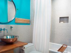One Neon Blue Wall By Erica Islas Enlivens This Otherwise Neutral Bathroom Beautiful Bathrooms