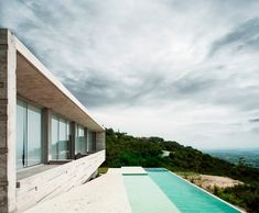 Mexican practice r-zero studio has completed 'widescreen house', a single family dwelling perched upon a hill  in jiutepec de morelos, mexico.