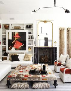 Eclectic living room with patterned ottoman and Serge Mouille light fixture on Thou Swell @thouswellblog