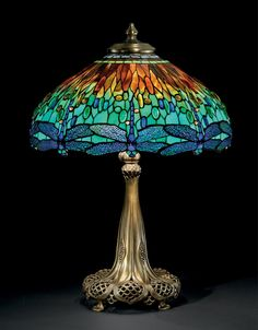 TIFFANY STUDIOS - A 'DRAGONFLY' LEADED GLASS AND BRONZE TABLE LAMP, CIRCA 1910