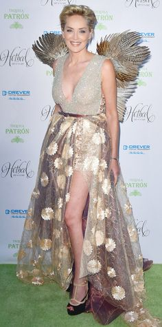 Sharon Stone's red carpet fashion took flight at the Fourth Annual Hotbed Gala in the most literal sense. The co-host wore an incredibly dramatic creation, featuring a plunging sparkle-encrusted bodice, a frothy floral-embroidered ball skirt, and two sets wings affixed from the back.