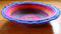 """. This week I experimented with crocheting over clothesline cord to make a bowl with a """"coiled basket"""" look. UPDATE: For more detailed instructions go to Crochet Coiled Basket Experimen…"""