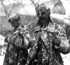 Two young German soldiers are amongst those who surrender to Scottish soldiers of the 52nd Lowland Infantry Division during heavy snowfall. Höngen, Heinsberg district, North Rhine-Westphalia, Germany. 20 January 1945