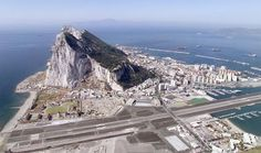 Gibraltar: Little tiny city attached to Spain, owned by the UK, and with a view to Africa. Coming from Spain, I had to cross that runway on foot. This place has primates) Rock Of Gibraltar, Places To Travel, Places To See, Travel Destinations, Malaga, British Overseas Territories, Beach Vibes, Spain And Portugal, Andalusia