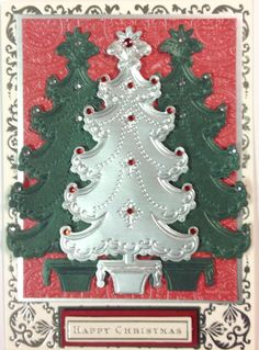 These trees were made using Anna a Griffin die and Embossing folder.  Christmas Arrangements - March 2014 Autoship #3