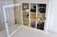 Perfume storage using glass display case -- love this!