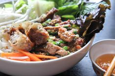 Vermicelli Noodles with Grilled Pork and Egg Rolls (Bun Thit Nuong Cha Gio) — Vietnamese Home Cooking Recipes Vietnamese Pork, Vietnamese Cuisine, Vietnamese Recipes, Vietnamese Sausage, Vermicelli Soup Recipe, Vermicelli Noodles, Egg Roll Recipes, Soup Recipes, Cooking Recipes