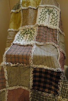 ... -made rag quilt with primitive colors and hand stitched willow trees