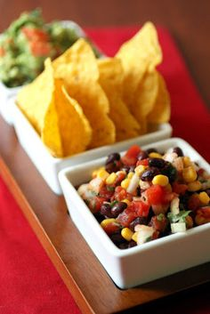 Black bean and corn salsa  served with with corn chips and guacamole
