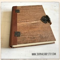 Wooden book covers from the papyrus plant and luxurious 280gsm recycled cardstock for the book body!