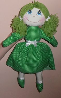 The doll made ​​of cotton.In the middle of the soft contribution cushion.The hair made ​​of wool.Details of dress finished with a ribbon with a bow.Painted face paint for fabrics.The height of about 42 cm.