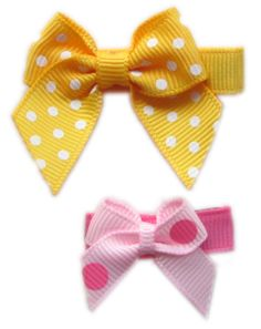 Directions for making a variety of hair bows, including these itty bitty baby bows that are just the right size for an infant.  Also includes instructions for making lined hair clips.