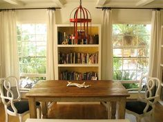 hang a candle if not electric pendant  eclectic dining room by Vanessa De Vargas