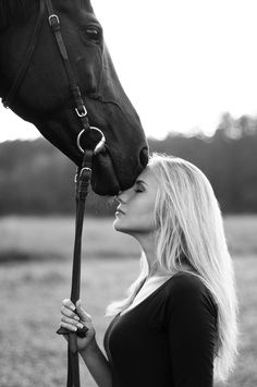 Either her horse is tall, or she's short for the horse to put his nose on her forehead.