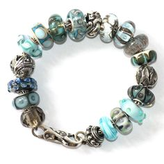 A lovely bracelet exhibiting the combination of soft grays and aquas.