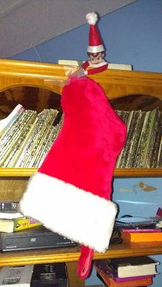 Elf on the shelf: Abby took down all our stockings and flipped them upside down. Elf On The Shelf, Christmas Stockings, Shelves, Holiday Decor, Home Decor, Shelving, Homemade Home Decor, Shelf, Open Shelving