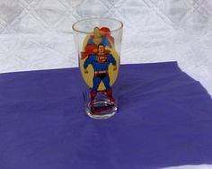 Superman glass.  I have a newer one but I need one like this too.