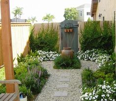 Surprising Minimalist Mediterranean Garden Design with Rich Colors and Wooden Wall Idea