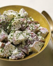 Warm Potato Salad with Goat Cheese from Martha Stwart. Tart goat cheese gradually melts onto warm vinaigrette-covered  potatoes to create a creamy coating.