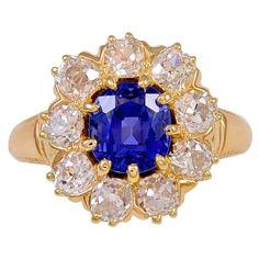 Tiffany & Co. Cushion Shaped Natural No Heat Sapphire Gold Ring. A rare Victorian Tiffany & Co. 2.46ct natural no heat cushion shape sapphire. Graded by the American Gemological Laboratories as natural, no heat, origin of Ceylon (Sri Lanka). The center sapphire is surrounded by nine Old European Cut diamonds with an estimated weight of 1.80cts total, all of which are set in 18kt yellow gold. c 1890s
