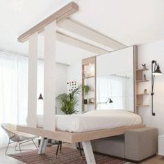 This bed lifts up to the ceiling and can be hoisted up the ceiling when not in use. It was designed by French furniture manufacture Décadrages as an alternative to the Murphy folding bed.