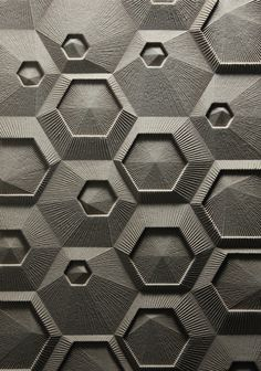 hxf_04 by Elijah Porter  Part of a series of work proposing new architectural surfaces. This is a grid of nested hexagons with linework radiating from the center of each module. It was designed, drawn and fabricated digitally. The material is mdf milled with a CNC router.