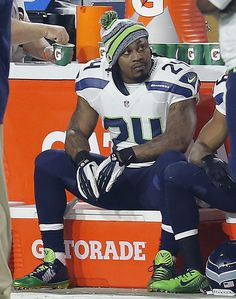 FILE - In this Dec. 21, 2014, file photo, Seattle Seahawks running back Marshawn Lynch watches from ... - (AP Photo/Rick Scuteri, File