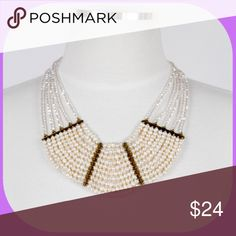 Layers upon Layers Statement Necklace Seed pearls and light translucent crystals come together in a classic statement necklace. Put it with a black dress for a striking evening evening look or wear it with dresses/blouses to work.  Clasp allows for adjustable length. The Impeccable Pig Jewelry Necklaces