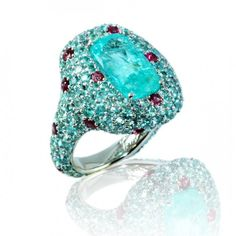 Antique Cushion Paraiba Tourmaline ring 18K white gold with Rubies. by Caroline C