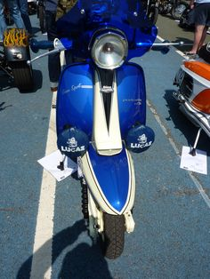 A well loved scooter with a blue screen and Lucas fog lights - nice