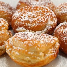 A sweet donut hole recipe cooked in a small cast iron pan. Aebleskiver - A Danish type donut Recipe from Grandmothers Kitchen. Iron Skillet Recipes, Cast Iron Recipes, Skillet Cooking, Delicious Donuts, Delicious Desserts, Yummy Food, Donut Recipes, Cooking Recipes, Donut Hole Recipe