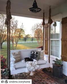 Swinging into the weekend... Absolutely in  with this porch swing by @cindimc.ivoryhome Check out her feed for more amazing posts! #repost #whowefollow #followfriday #frontporch #porchswing #ropes #weekend @pineapplespalms