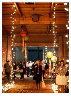 great idea to have the lights bunched up in a row on the floor in the entrance..cute for a barn wedding too