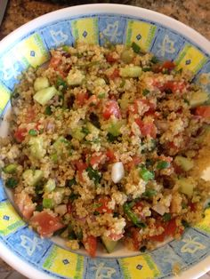 Easy and healthy quinoa salad with cucumber, tomato, cilantro and green onion. Added some fresh avocado too. Yum!