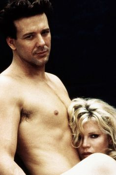 Mickey Rourke & Kim Basinger, 9 1/2 Weeks If you haven't seen 9 1/2 Weeks, the notion of late-night snacking doesn't sound like the most romantic foreplay, which is a shame, because it is. The sexual relationship between Mickey Rourke and Kim Basinger isn't exactly healthy, but it sure is hot. Did you know Mickey Rourke was a gorgeous specimen, once upon a time? Because he was.