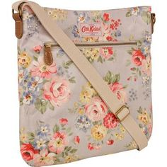 Stylish and practical, this cross body bag is easy to wear with adjustable strap and classic shape, great for holding all your daily essentials.  Don't let the pretty Spring Bouquet print fool you, it's completed in our practical oilcloth to ensure durability.  Finished with magnetic closure, with zip interior and exterior pockets.  Keep all your accessories in tune with matching folded zip wallet.