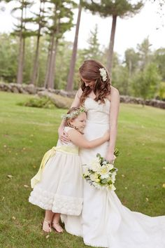 Sweet flower girl and bride photo by Emily Delamater Photography | via junebugweddings.com