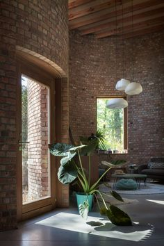 Tall, rectangular windows puncture the walls and there are glass doors on the ground floor to bring even more light to the interiors of this house. Brick Tiles, Brick Wall, Brick Building, Building A House, Site Plan Design, Cladding Materials, Recycled Brick, Brick Architecture, Brick Design