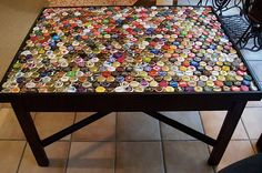 """""""Bottle Cap Art"""".....All over the world people enjoy a cold beer now and then and throw away the bottle caps, assuming they are just trash. From cool wall decorations, picture frames, mirror frames, candle holders, bowls to a whole table and chair designs out of bottle caps. These ideas will definitely inspire you not to throw the cap, the next time you open a new bottle of beer or soda."""