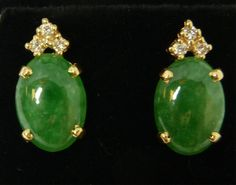 """PAIR OF 14K YG APPLE JADEITE AND DIAMOND EARRINGS  Beautiful pair of 14 karat yellow gold earrings holding oval cabochon jadeite stones each measuring approx. 13.2mm x 9.4mm x 3.0mm. Each earring holds 3 brilliant cut prong set diamonds approx. 0.15ctw. Stunning translucent white to apple green jadeite colors. Each measures 3/4"""" height (1.9cm)."""