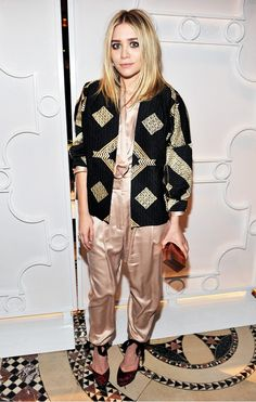 Ashley in a gold-embellished coat and champagne satin jumper.