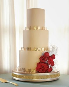 "A Cake That Sings: Sugar peonies and the lyrics to ""Auld Lang Syne"" decorated the wedding cake at this New Year's Eve celebration."