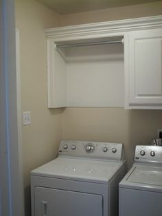 Built-In hanging rod over dryer. Perfect for items that shrink in the dryer or need to be air dried