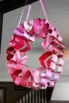 Learn how to make this simple Valentine's Day Paper Heart Wreath at TheInspiredHome.org