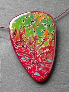 A mokume gane pendant necklace made from polymer clay by Vert Cerise.