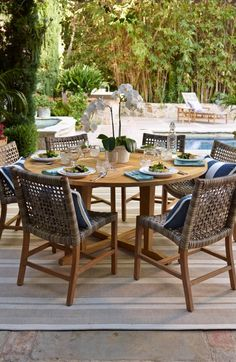 With a breathable open weave and solid teak frames, our Isola Dining Collection is the perfect fit for arid and coastal climates alike. | Frontgate: Live Beautifully Outdoors